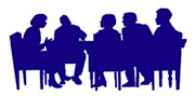 Silhouette of a council meeting in a board room.